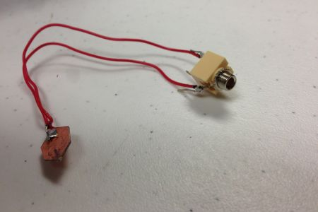 copper clad with 2 wires soldered, other ends of wire soldered to monojack