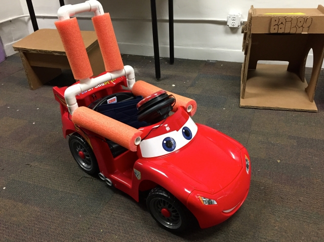 A modified ride on top bright red car.